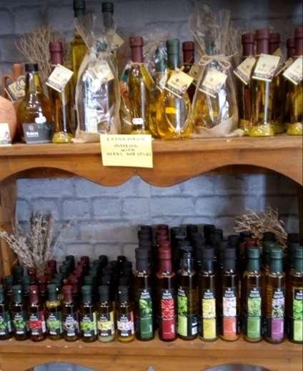 Delicatessen Bottles in shelf - Rhodes Greece